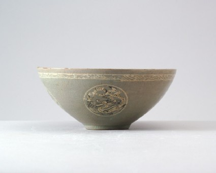 Greenware bowl with dragons and a flowerfront