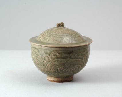 Greenware bowl and lid with floral decorationfront
