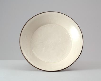 White ware bowl with ducks swimming between lotus plantstop