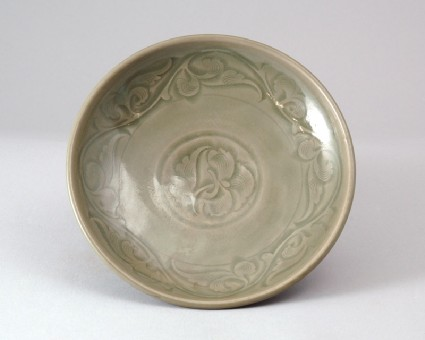 Greenware dish with floral decorationfront