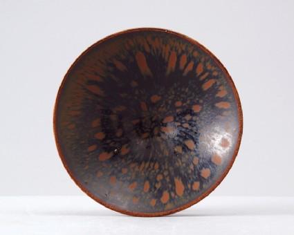 Black ware tea bowl with 'partidge feather' glazestop
