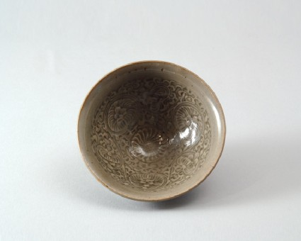 Greenware bowl with floral decorationfront