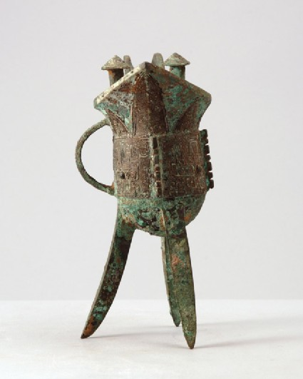 Ritual tripod wine vessel, or jue, with taotie mask patternfront