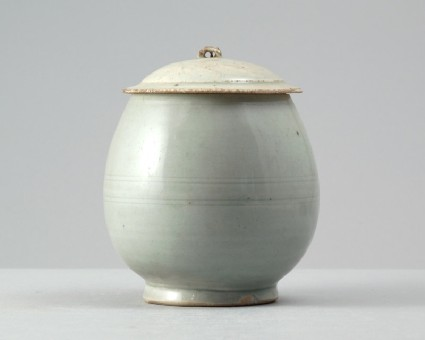 White ware vase and lid with floral decorationfront