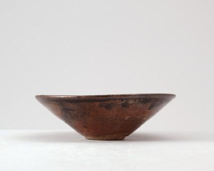 Black ware tea bowl with prunus under a crescent moonfront