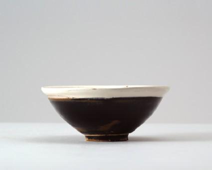 Black ware bowl with white rimfront