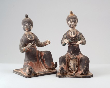Figure of a seated female attendantfront