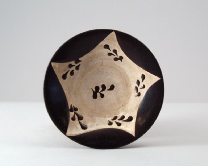 Black ware bowl with leaf decorationfront