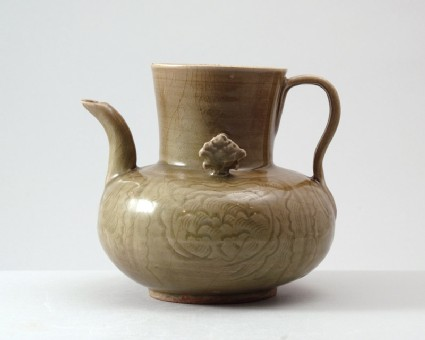 Greenware ewer with peony decoration amid wavesside