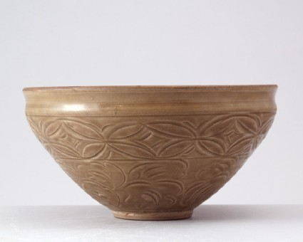 Greenware bowl with waves and floral decorationfront