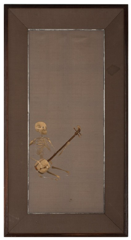Skeleton kneeling playing a shamisen, or plucked instrumentfront, Cat. No. 38